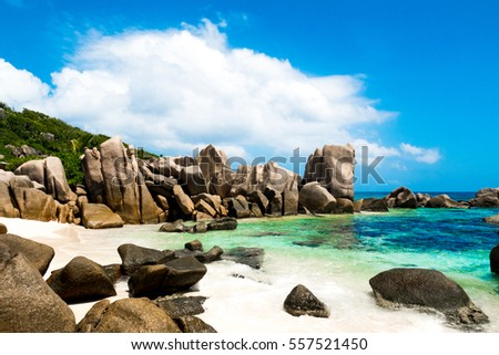 The path to Anse Marron beach in La Digue, Seychelles, a tropical natural beach with green lagoon white sand and big rocks