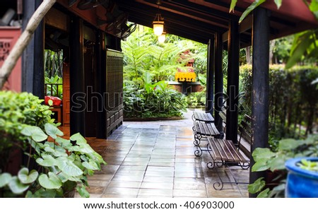 The patio of one of the houses in the Jim Thompson House museum in Bangkok, Thailand. - stock photo