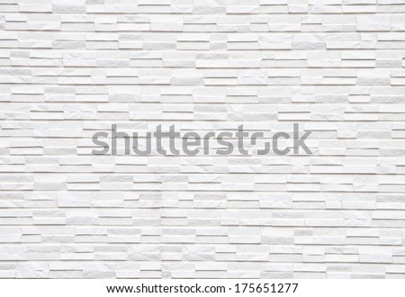 The pattern of sand stone tile wall background