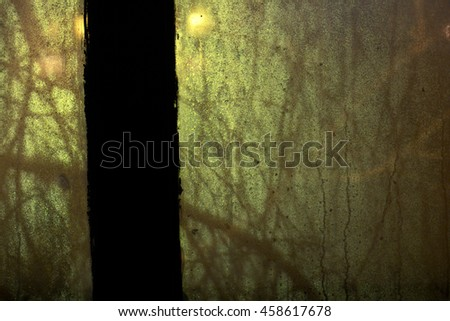 The patterns made by the drops on the window back (wet background with tree branches shadows). Selective focus. - stock photo
