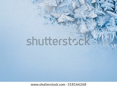 The patterns made by the frost on the window - stock photo