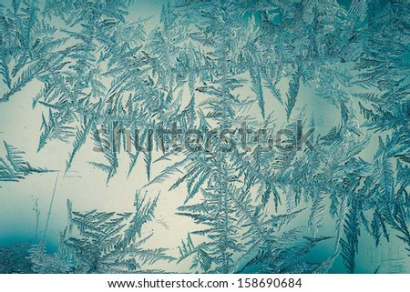 The patterns made by the frost on the window (hoarfrost background)  - stock photo