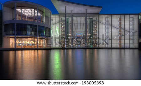 The Paul-Loebe-Haus, part of the government buildings around the Bundestag of Germany in Berlin, with the river Spree in the foreground. - stock photo