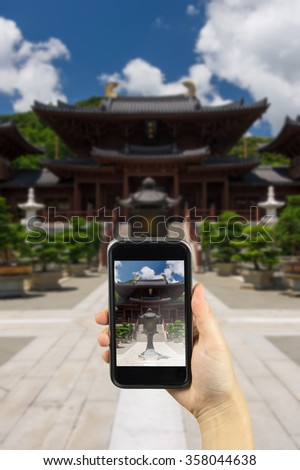 The Pavilion of Absolute Perfection in the Nan Lian Garden, Hong Kong. Taking photo on smart phone concept.    - stock photo