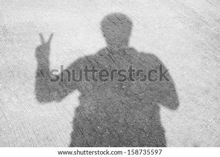 The peace sign shadow
