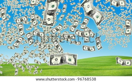 the peacefull blue sky and grass and dollar flying - stock photo