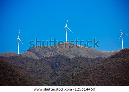 The peak power generation windmill - stock photo