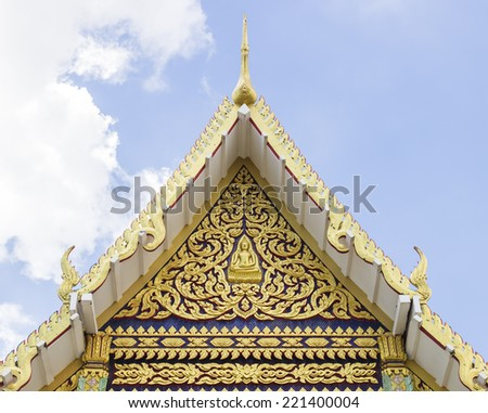 The pediment of the temple in Thailand, A Buddhist temple - stock photo