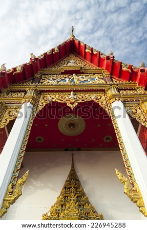 The pediment of the temple, Thailand, This is a Buddhist temple - stock photo