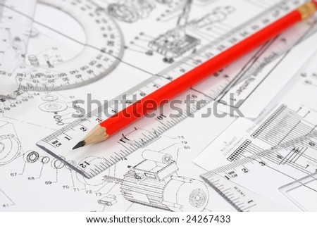 The pencil and ruler lie on the drawing