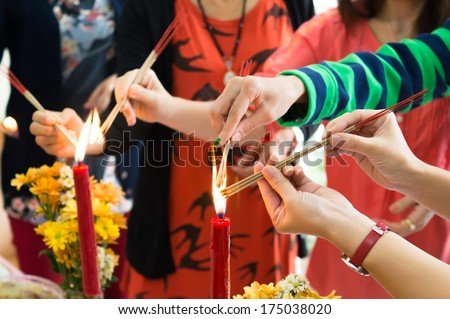 The people are kindle fire the incense on Chinese new year in Thailand - stock photo
