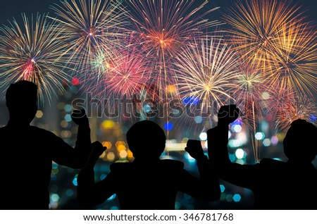 The people looks Fantastic festive new years colorful fireworks on cityscape blurred photo bokeh,project success, holiday concept, family concept