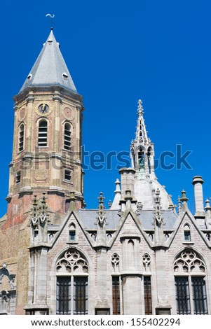 The Peperbusse and fragment of Church of Saint Peter and Saint Paul in Ostend in Belgium - stock photo