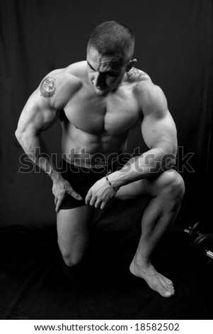 The Perfect male body isolated on black background - stock photo