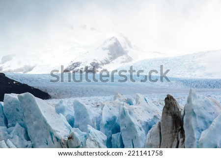 The Perito Moreno Glacier is a glacier located in the Los Glaciares National Park in southwest Santa Cruz province, Argentina. This icefield is the world's third largest reserve of fresh water. - stock photo