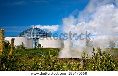 The Perlan and small geyser in Reykjavik, Iceland. - stock photo
