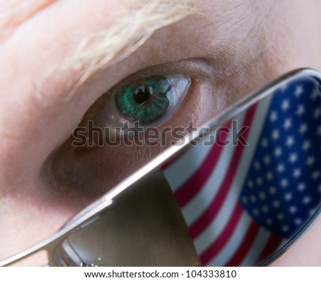 The person in dark glasses attentively looking at you. - stock photo