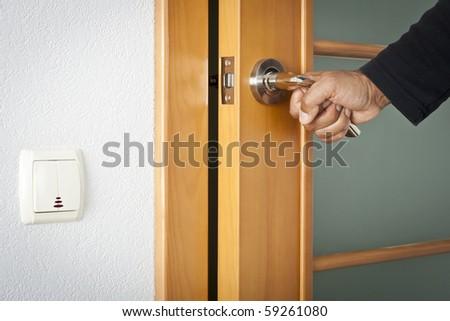 The person opens an interroom door - stock photo