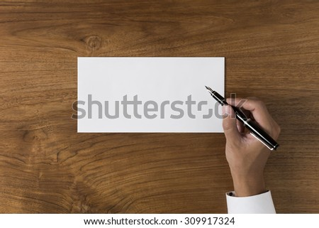 The person who is going to write what it is with a pen - stock photo
