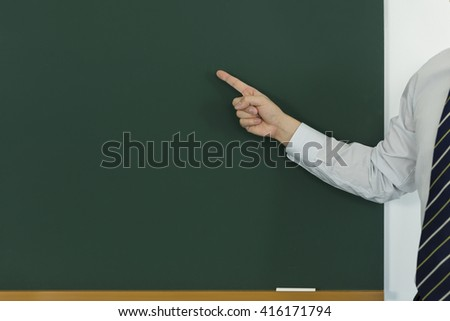 The person who points at a blackboard - stock photo