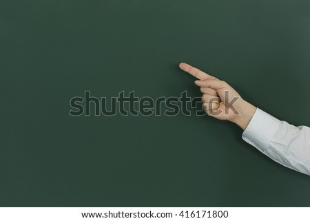 The person who points at a blackboard
