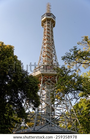 The Petrin lookout tower on Petrin Hill in Prague, Czech Republic. It is built in 1891 and is a 63.5 metre high. It resembles the Eiffel Tower and is a major tourist attraction. - stock photo