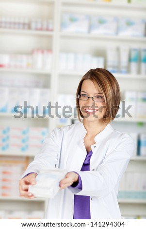 The pharmacist sells the medicine in a pharmacy drugstore
