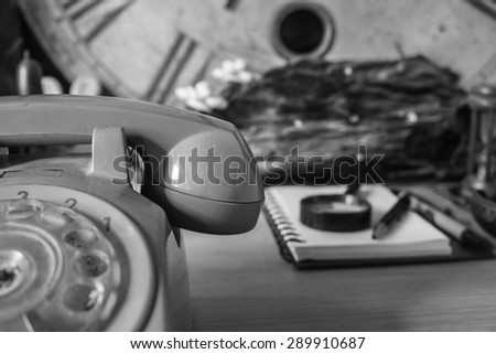 The phone on the desk with a black and white image.