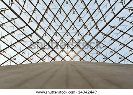 The photo is made under a glass dome of a pyramid in the Louvre - stock photo