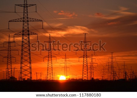 The photo of electric power transmission lines at sunset. Little noise - stock photo