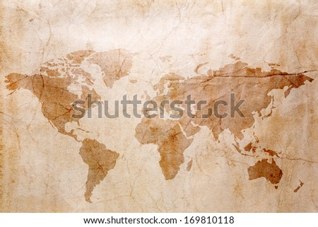 the photo of old paper, with a spot from coffee in the form of the map of the earth - stock photo
