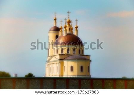 The photo shows the building of an orthodox church yellow coloring