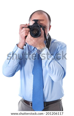 The photographer and reflex camera in photographic studio