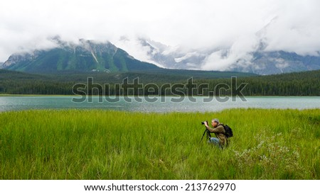 The photographer at work in the Jasper National Park in the Canadian Rockies.   - stock photo