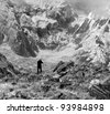 The photographer shooting Annapurnu from base camp (black and white) - Nepal - stock photo