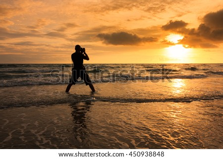 The photographer taking sunset on Rayong beach