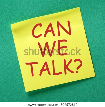 The phrase Can We Talk? in red text on a yellow sticky note posted on a green notice board as a reminder that discussion and dialog works - stock photo
