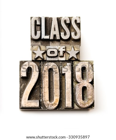 "The phrase ""Class of 2018"" in letterpress type. Cross processed, narrow focus."