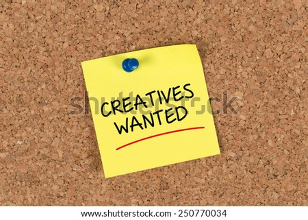 The phrase Creatives Wanted written on Sticky Note - stock photo