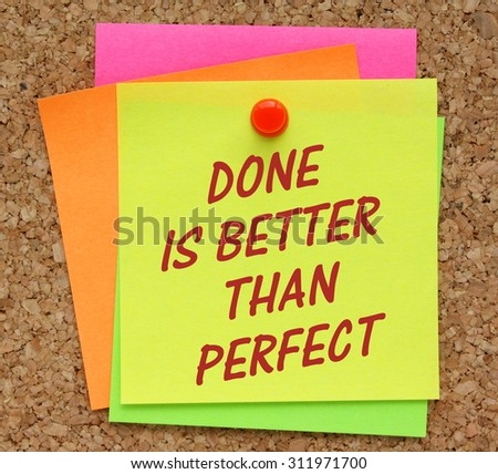 The phrase Done Is Better Than Perfect in red text on a yellow sticky note pinned to a cork notice board as a reminder it is sometimes better to get a product to market than waiting for perfection.  - stock photo
