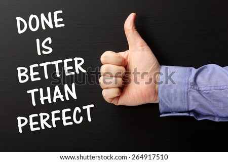 The phrase Done is Better Than Perfect on a blackboard with a hand giving a thumbs up gesture, as a reminder it is sometimes better to finish and move on to the next challenge - stock photo