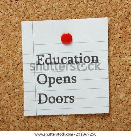 The phrase Education Opens Doors typed on a piece of lined paper and pinned to a cork notice board - stock photo
