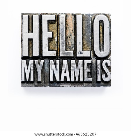 "The phrase ""Hello, my name is"" in letterpress type. Cross processed, narrow focus."