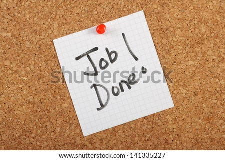 The phrase Job Done hand written on a piece of graph paper and pinned to a cork notice board