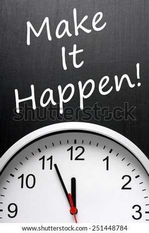 The phrase Make It Happen written on a blackboard next to a modern clock to emphasize the deadline - stock photo