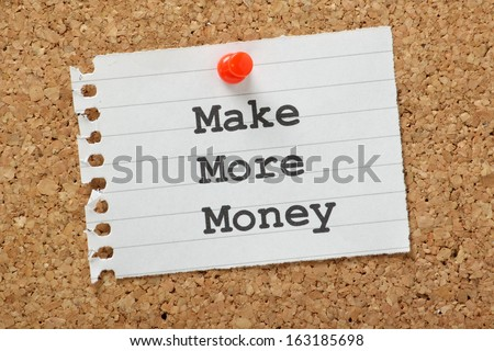 The phrase Make More Money typed on a piece of note paper and pinned to a cork notice board - stock photo