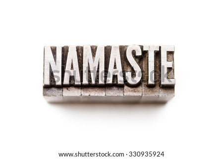 "The phrase ""Namaste"" in letterpress type. Cross processed, narrow focus."
