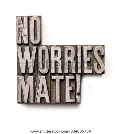 "The phrase ""No Worries Mate"" in letterpress type. Cross processed, narrow focus."