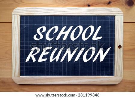 The phrase School Reunion in white text on a slate blackboard - stock photo