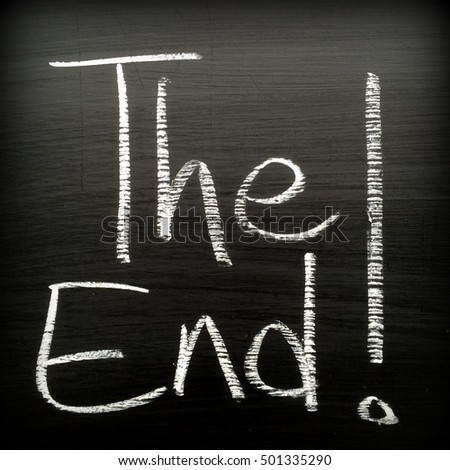 The phrase The End! written in white chalk on a blackboard. Vignette added for effect